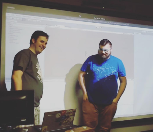 Eric Lathrop and Alex bezuska of Two Scoop Games showing their creation Kick Bot DX at the Kentucky Fried Pixels game Jam, Louisville Kentucky June 11th